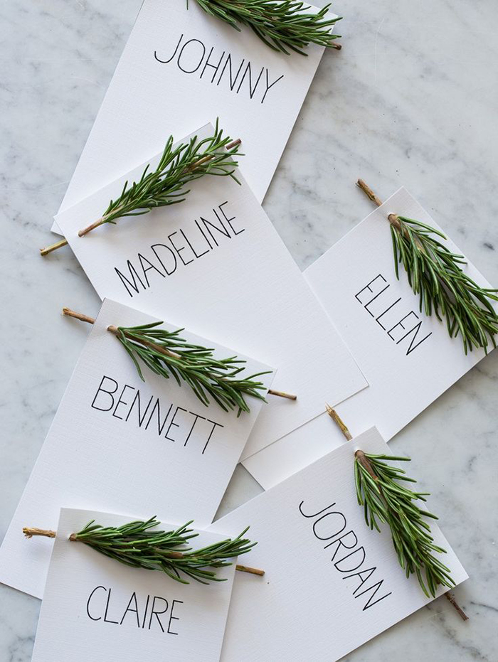 name cards with rosemary sprigs